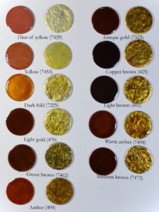 Figure 10: Yellow and brown transparent enamels applied directly on copper base and direcly on pure silver foil.